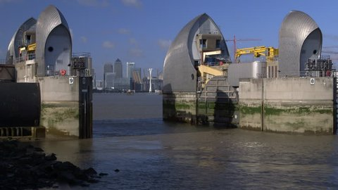 Thames River flood gate raises - metaphor for London UK raising barriers to EU membership following Brexit Great Britain