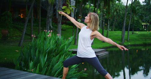 Woman practicing yoga, health and wellness concept