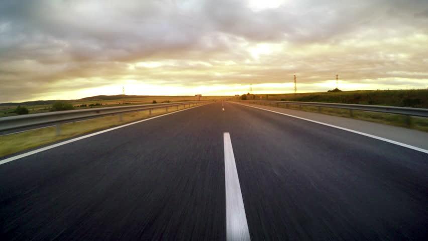 Sport car driving fast on morning highway sunrise, 4k | Shutterstock HD Video #21934171