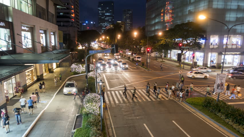 Manila, Philippines - December 3, 2016: Timelapse of a night traffic in Makati City shopping districts in Metro Manila. Philippines.