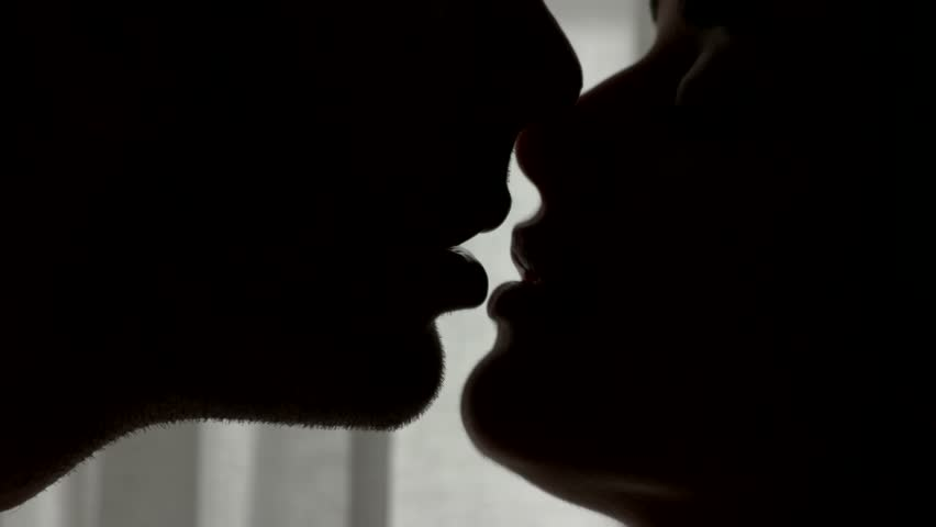 Lips of kissing couple. Faces of woman and man. Addicted to your kisses. Nobody can separate us.