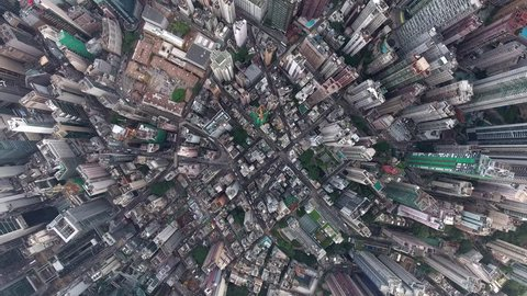 Top view aerial video above commercial cityscape of megalopolis with highly developed architecture and industry with offices and headquarters of biggest companies in world, can be used for advertising