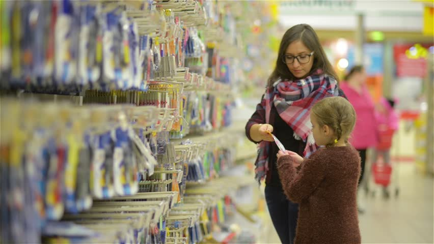 Young Mother and Her Daughter Doing Shopping Together in the Store. Woman Wearing Checkered Shawl and Glasses Chooses with Little Girl What to Buy in the Supermarket | Shutterstock HD Video #22067035