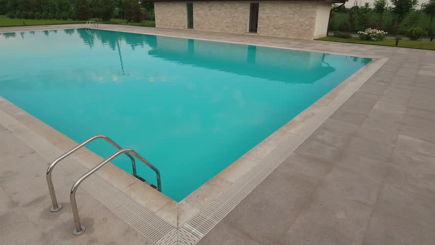aerial view of an outdoor swimming pool 4k stock video clip