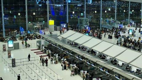 BANGKOK, THAILAND - DECEMBER 9, 2016: Passengers wait at the check in queue in departure terminal of Bangkok Suvarnabhumi Airport. Bangkok Airport is one of the busiest international airports in Asia.