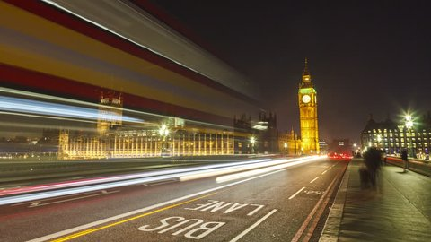 Big Ben time-lapse on the Westminster Bridge in London at Night , hyper lapse slow movement to the Big Ben. Long shutter speed with long light trails.