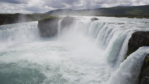 Iceland landscape scenic view of Godafoss waterfall against cloudy sky. It is one of the famous tourist attractions. It is a spectacular Icelandic waterfall on the North of island. 90 FPS RED EPIC.