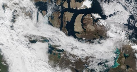 High-altitude overflight aerial of partial opening of the Northwest Passage, Canadian arctic. Clip loops and is reversible. Elements of this image furnished by NASA