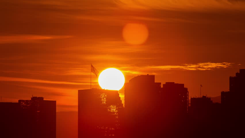Time lapse of the sun rising from behind the buildings of downtown San Diego. | Shutterstock HD Video #22201495