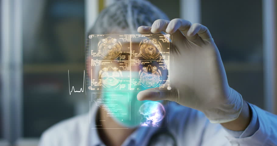 A physician, surgeon, examines a technological digital holographic plate represented the patient's body, the heart lungs, muscles, bones. Concept: Futuristic medicine, the human body, and the future. | Shutterstock Video #22212229