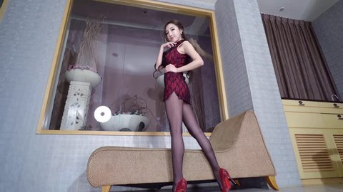 sexy beautiful asian japanese model young lady Pin Up girl black pantyhose woman posing in chinese style dress mini skirt with attractive body sex pose showing legs bottom up view
