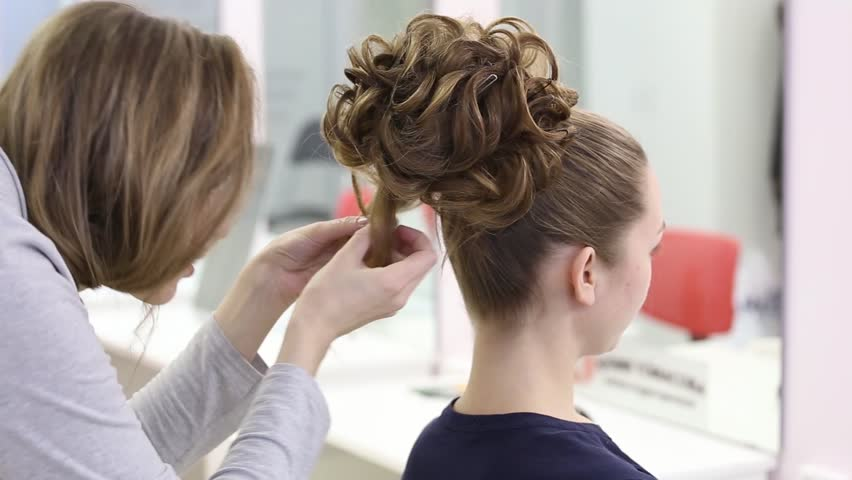 Professional Hairdresser Doing Hairstyle With Bun And Curls For - Hairstyle bun videos