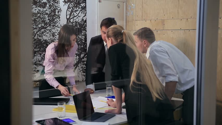 Business partners discussing project at meeting | Shutterstock HD Video #22271959