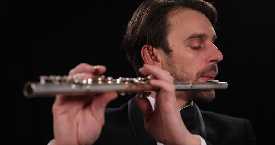 Musician Singing Flutist Playing Flute Instrument Symphonic Orchestra Soloist. Ultra High Definition, UltraHD, Ultra HD, UHD, 4K, 2160P, 4096x2160