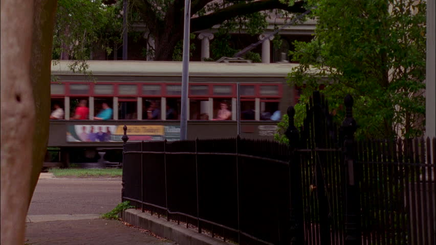 Day Tilt down, porch roof, passing trolley New Orleans (Nov 2005) | Shutterstock HD Video #22303045