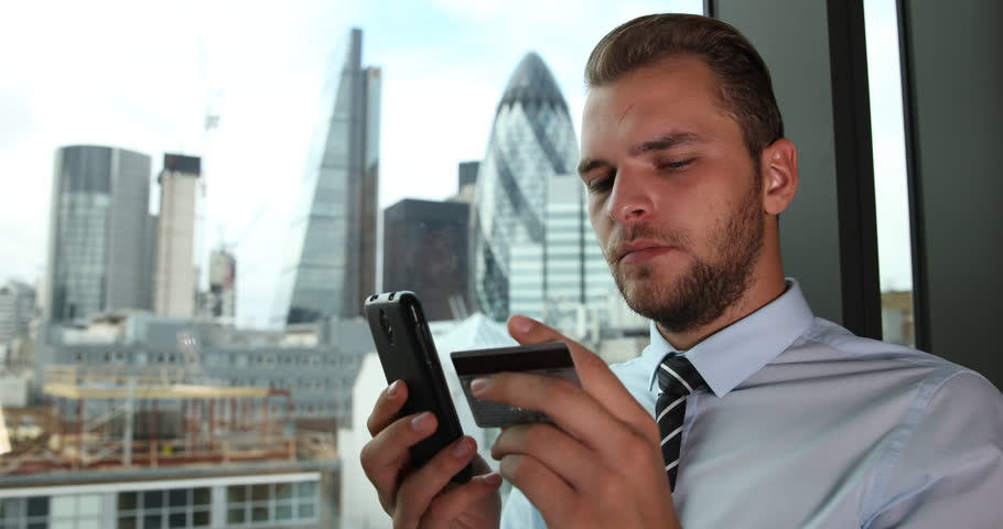 Business Man Using Credit Card Shop Online Banking Mobile Phone London Skyline. Ultra High Definition, UltraHD, Ultra HD, UHD, 4K, 2160P, 4096x2160   Shutterstock HD Video #22313638