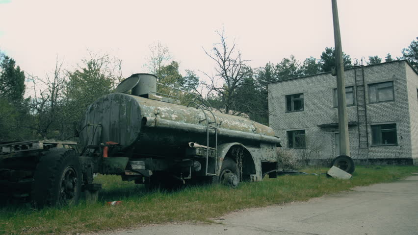 Radioactive Waste in the Chernobyl Zone. Nature Destroys Cars. Cars Abandoned People and Time. Radioactive Transport in the Exclusion Zone. Peeling Paint of the Car. the Wheel of the Car. Old Pneu a