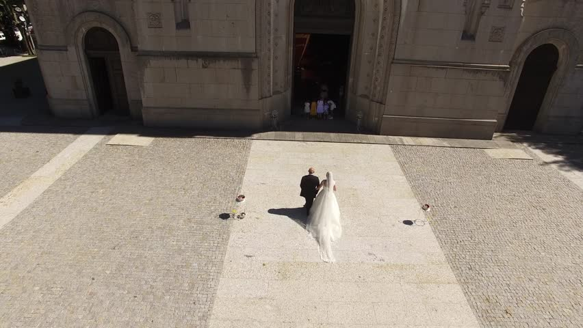 Bride entering with her father in the church to get married, Aerial View made by Professional Drone Wedding Day