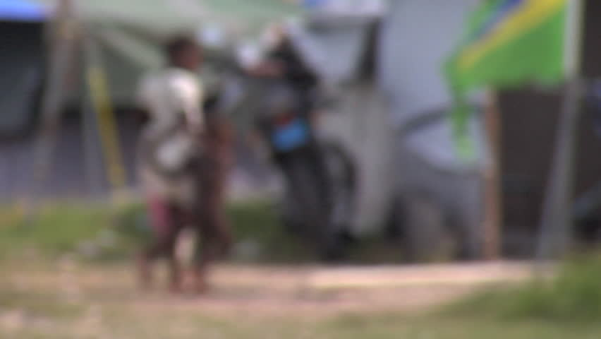 PORT-AU-PRINCE - CIRCA OCTOBER 2010: Young Haitian children in a tent city in Port-au-Prince, Haiti circa October 2010.