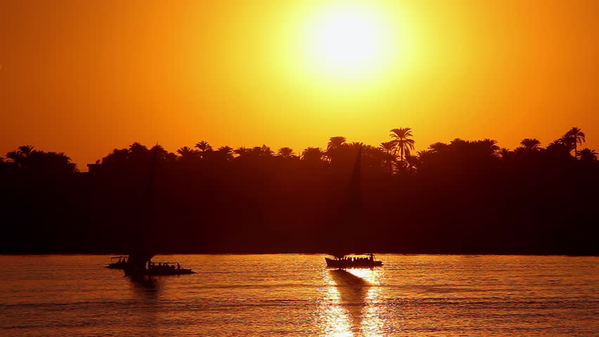 Feluccas & Tourist Boats At Sunset; River Nile Luxor Egypt