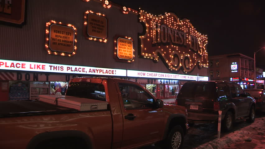 Toronto, Ontario, Canada December 2016 Iconic Honest Eds department store neon signs flashing at night   Shutterstock HD Video #22409575