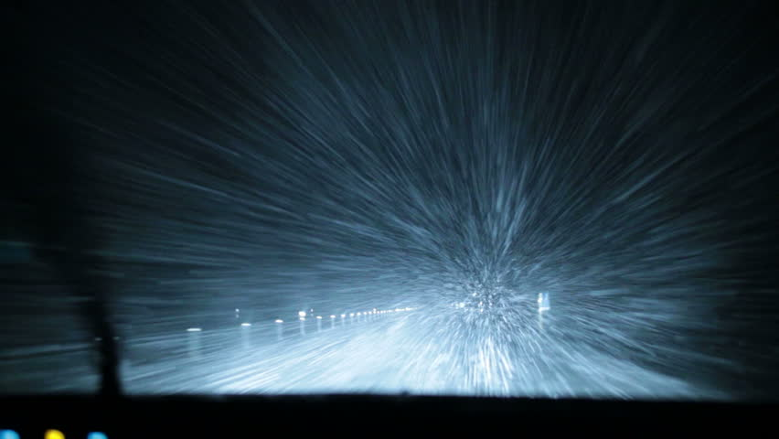 Intense blizzard snow storm gale force wind whiteout night extreme weather driving POV