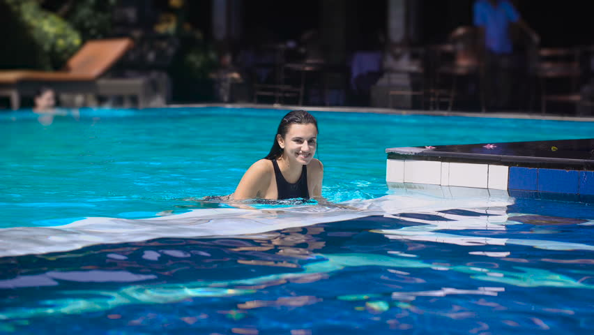 Young happy girl in swimsuit raises leg on mat in morning for Pool floats design raises questions