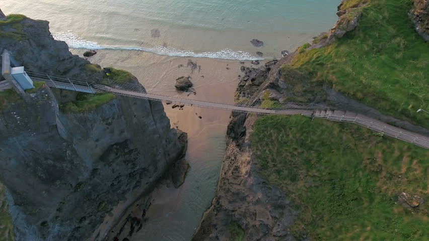 Aerial view of the Carrick-a-Rede Rope Bridge in Ireland where a bridge connecting the two rock formation in the cliff in Ireland