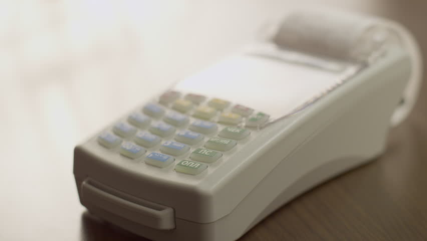Female hand use the mobile terminal that gives receipt. | Shutterstock HD Video #22460335