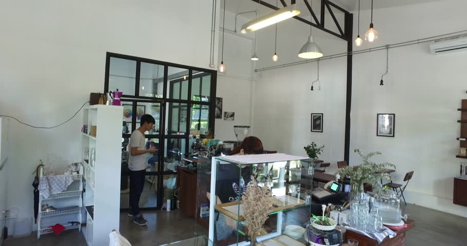 CHIANG MAI,THAILAND - November 2016: Stylish coffee shop Asian staff working at counter in Chiang Mai | Shutterstock HD Video #22478545