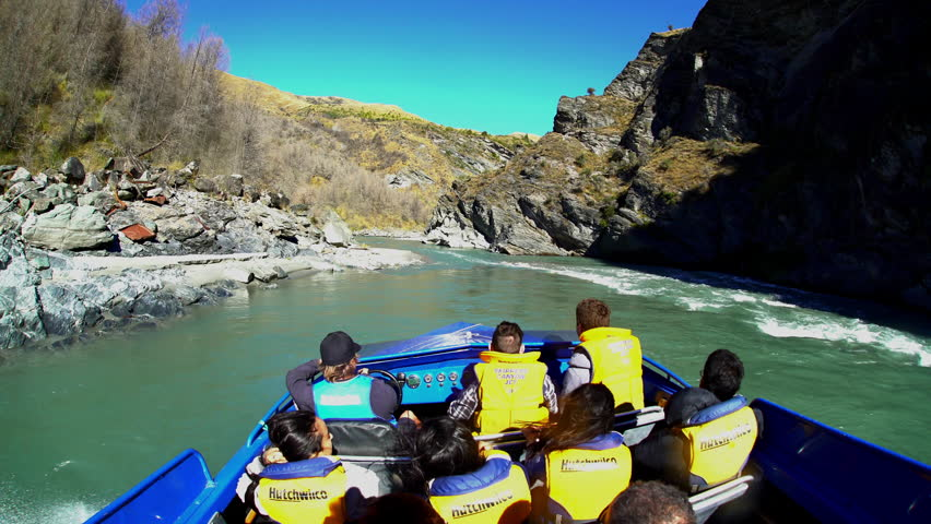 Thrilling adventure ride at speed through canyon on Jet Boat Shotover River Queenstown South Island New Zealand