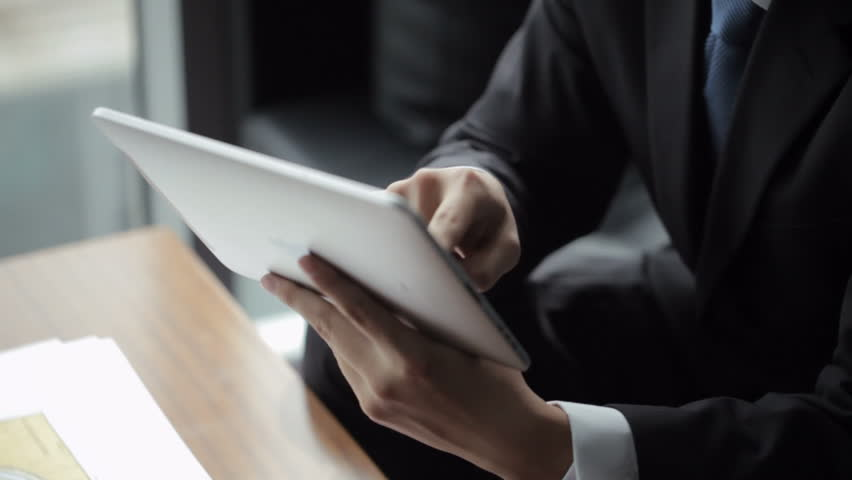 TU CU Businessman using digital tablet in front of window / Beijing, China | Shutterstock HD Video #22502785