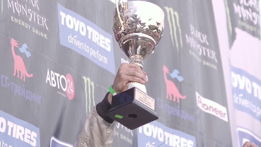 Ryazan, Russia - September 1, 2016 : Award ceremony for winners of drift series in Ryazan, Russia on September 1, 2016. The first-placed party with champagne.