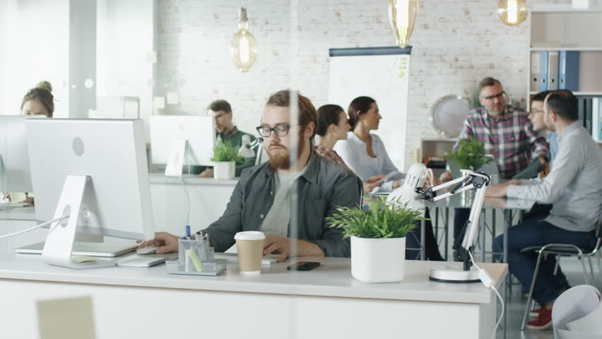 Weekday in a Busy Creative Bureau. Diverse Cast of People at Work. Office Workers Sit at Their Personal Computers. At the Big Table Have Planning Session.Shot on RED EPIC (uhd). | Shutterstock HD Video #22521055