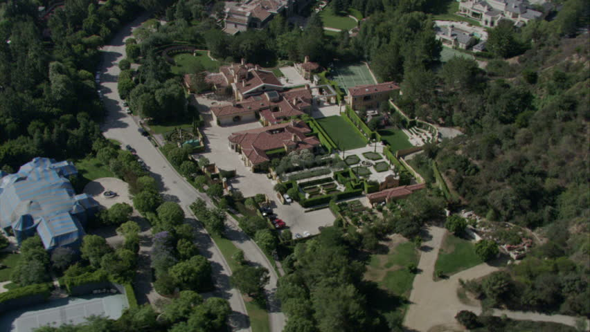aerial shot of mansions in an elite neighborhood with expansive lots and manicured foliage circa 2009