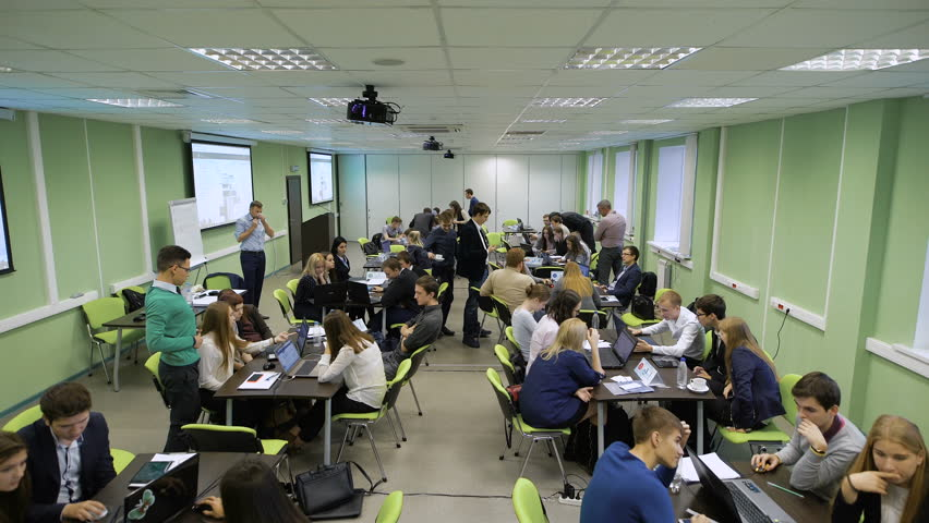 Young professionals in the business game in an educational institution. Audience Overview. Team during a break. | Shutterstock HD Video #22555735