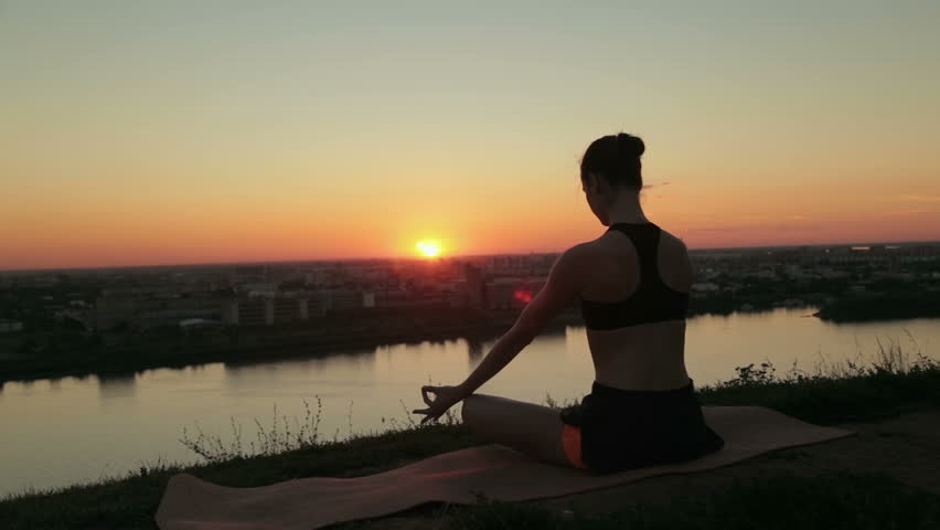 6 shots. Sporty woman in lotus position in the park at sunset. Lotus mudra. Sunset light, golden hour, lens flares. Freedom, health and yoga concept | Shutterstock HD Video #22585825