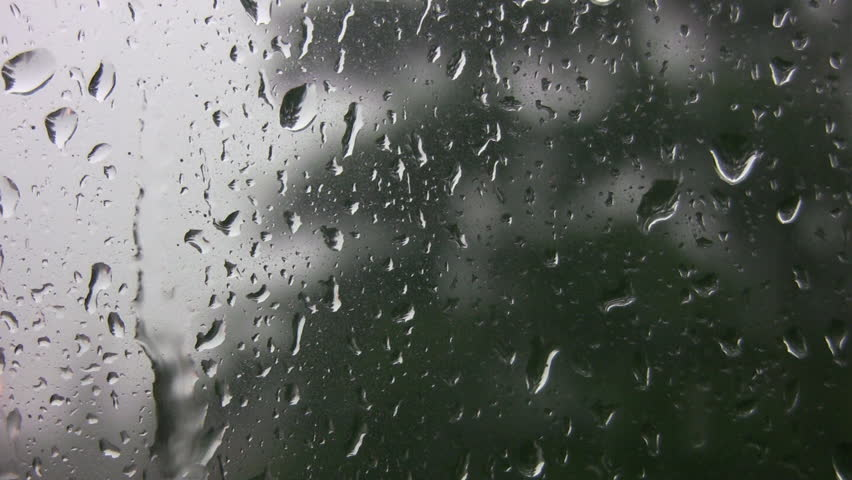 Rain running down window.