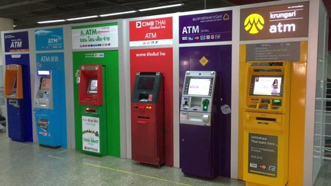 BANGKOK - DECEMBER 12, 2016: A row of ATMs at the Don Mueang International Airport. It is one of two international airports serving Greater Bangkok, the other one being Suvarnabhumi Airport.