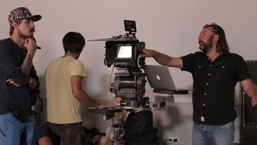 KYIV, UKRAINE  –  AUGUST  23, 2015. The backstage of filmmaking. Film crew at work on the shooting   Shutterstock HD Video #22637434