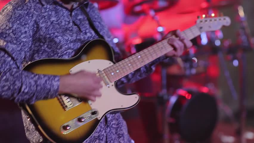 Man's hand touching the strings, playing the guitar, create a melody concert on cover band. | Shutterstock HD Video #22643905