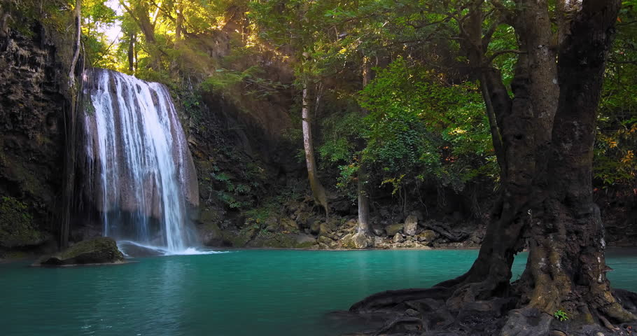 Clear waterfall flowing down turquoise clean river surrounded by jungle trees. Perfect place for relaxation in wild nature. Rainforest full of green plants. Summer time in remote forest | Shutterstock HD Video #22654195