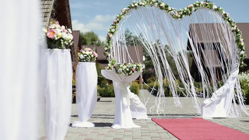 Beautiful Wedding Arch With Ribbons In Ceremony Flowers On The Way To