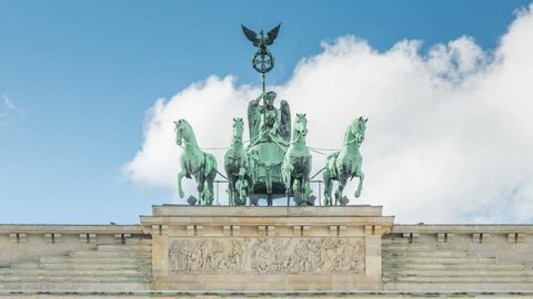 Berlin. Brandenburger gate chariot, drawn by four horses. Brandenburg Gate (Brandenburger Tor) is an 18th-century neoclassical monument, and one of the best-known landmarks of Germany
