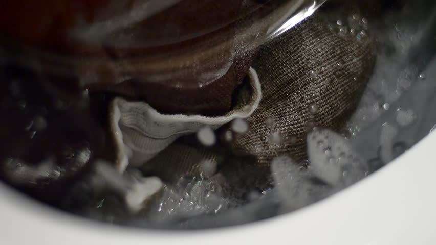 Laudry Spinning In The Washing Machine, Front Shot, Detail