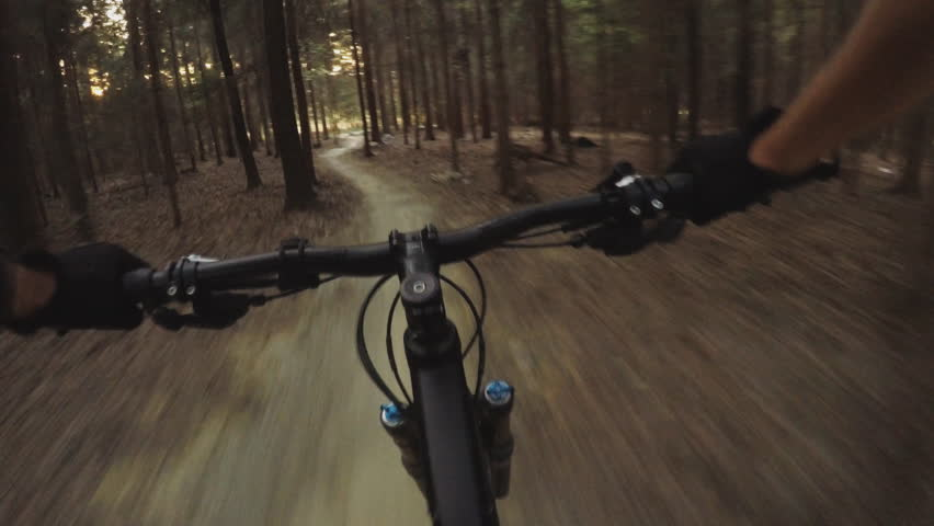 MTB bike riding on enduro mountain track trail in autumn forest. Mountain biking downhill in woods. View from first person perspective POV. Gimbal stabilized video.  | Shutterstock HD Video #22706371
