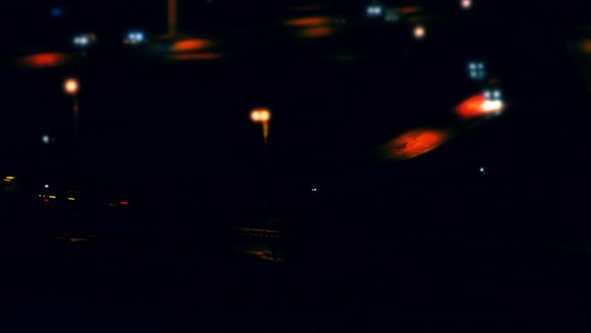 Cars Traffic. 4x fast motion cars driving on a road junction in the night city. Tilt shift. (av31553c)