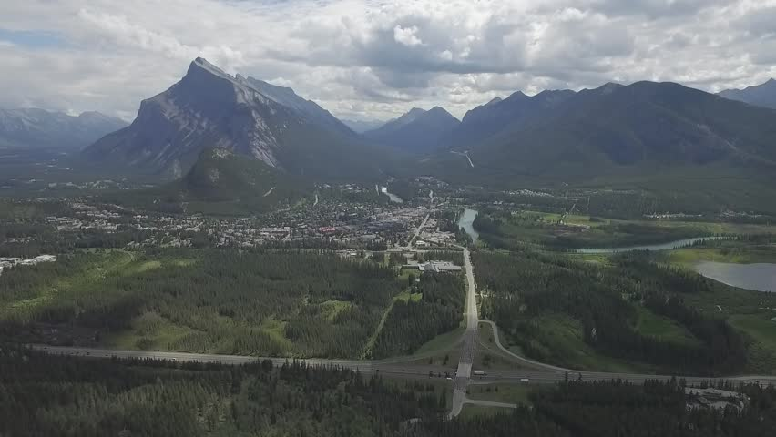Banff National Park Alberta over highway Snow Peak mountain view sunny day aerial