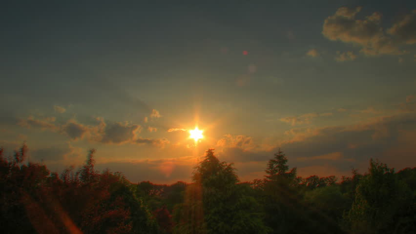 Sunset time lapse over trees, high dynamic range imaging