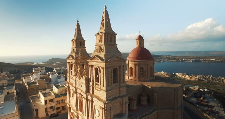 Aerial shot flying away from a church in Mellieha Malta